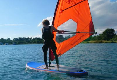 adult windsurfer